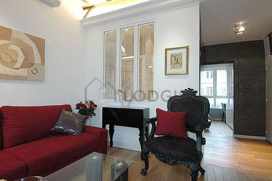 Séjour équipé de 1 canapé(s) lit(s) de 140cm, air conditionné, télé, 1 fauteuil(s)