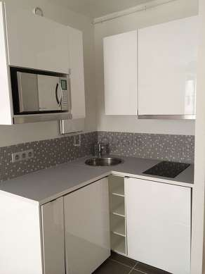 Kitchen equipped with washing machine, dryer, freezer, crockery