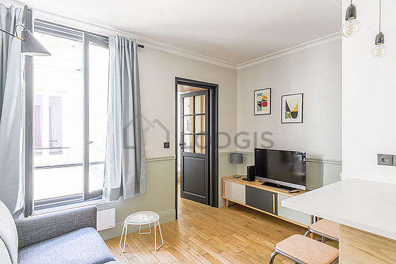 Very quiet living room furnished with 1 sofabed(s) of 140cm, tv, storage space, cupboard