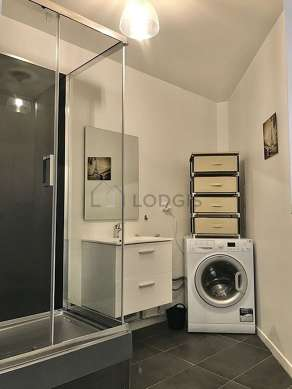 Bathroom equipped with washing machine, separate shower
