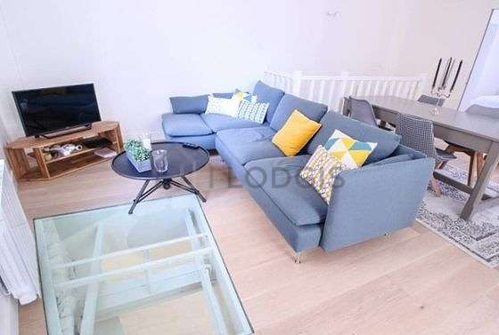 Very quiet living room furnished with tv, storage space, 6 chair(s)