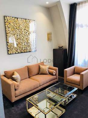 Very quiet living room furnished with air conditioning, tv, 1 armchair(s)