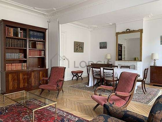 Very quiet living room furnished with tv, dvd player, 2 armchair(s), 6 chair(s)