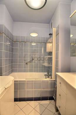 Bathroom equipped with washing machine, bath tub