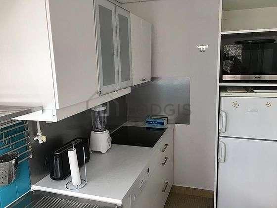 Kitchen equipped with washing machine, crockery