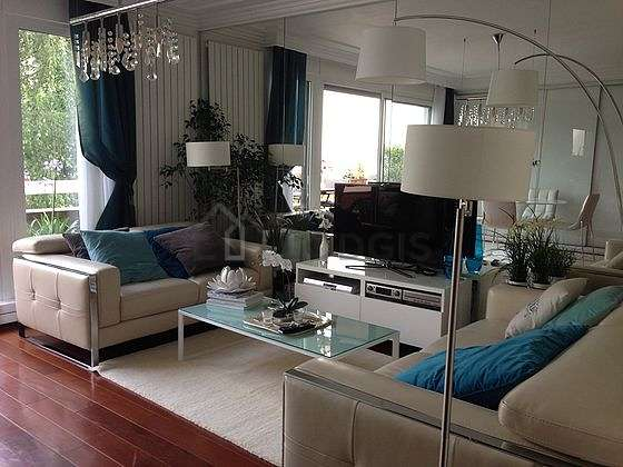 Very quiet living room furnished with tv, hi-fi stereo, wardrobe, cupboard