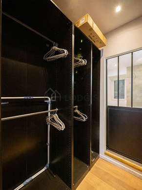 Very quiet and clair walk-in closet with woodenfloor