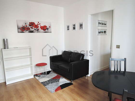 Living room furnished with tv, storage space, cupboard, 1 chair(s)