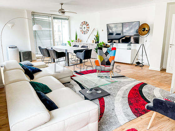 Living room furnished with tv, 1 armchair(s), 1 chair(s)