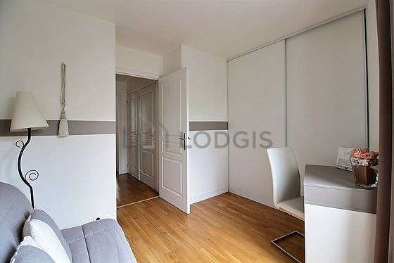 Very beautiful office with woodenfloor furnished with sofa, wardrobe, closet