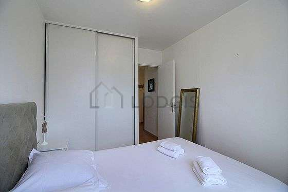 Very bright bedroom equipped with cupboard