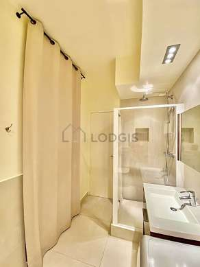 Bathroom equipped with washing machine, dryer