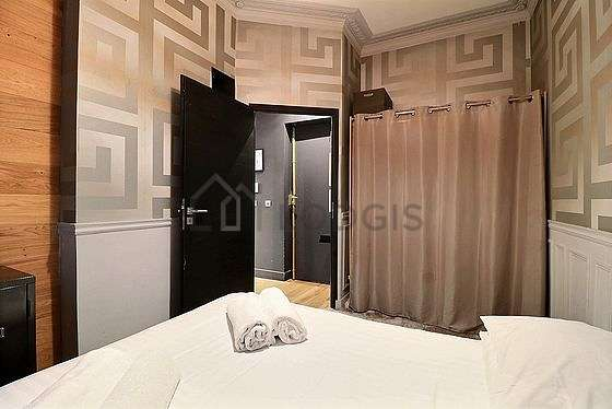 Bright bedroom equipped with air conditioning, fan