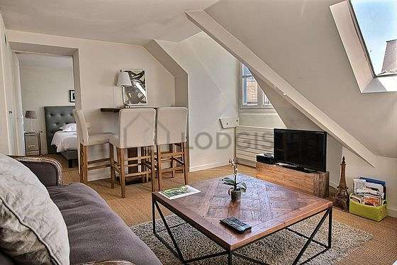 Very quiet living room furnished with tv, 4 chair(s)