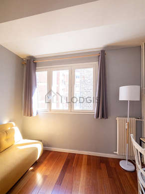 Bright bedroom equipped with sofa, 1 chair(s)