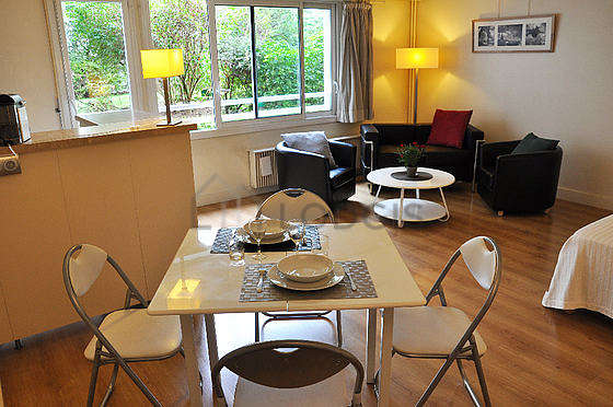 Very quiet living room furnished with 2 bed(s) of 90cm, tv, fan
