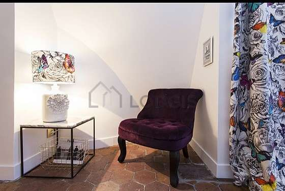 Nice alcove with floor tilesfloor close to the living room