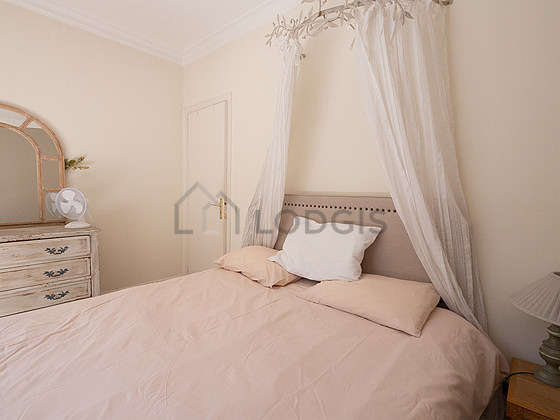 Very bright bedroom equipped with tv, sofa, 1 armchair(s), 1 chair(s)