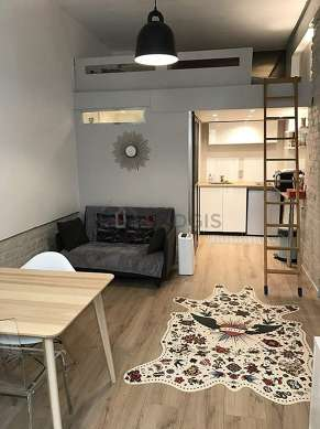 Living room furnished with 1 loft bed(s) of 160cm, tv, cupboard, 1 chair(s)