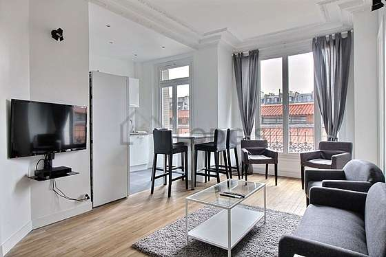 Very quiet living room furnished with tv, 3 armchair(s)