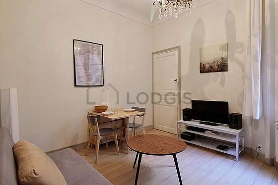 Very quiet living room furnished with tv, 2 chair(s)