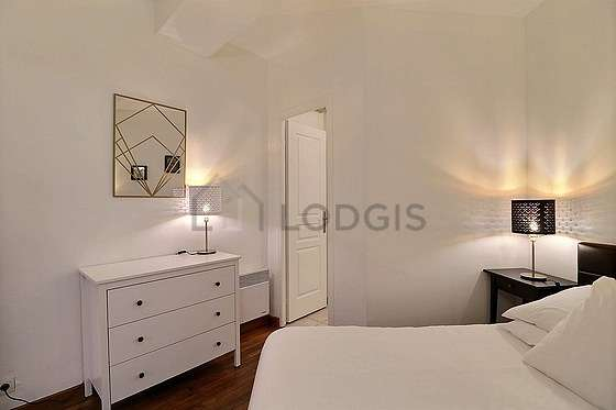 Bedroom equipped with fan, bedside table