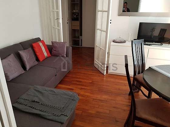 Very quiet living room furnished with 1 sofabed(s) of 160cm, tv, storage space, 1 chair(s)