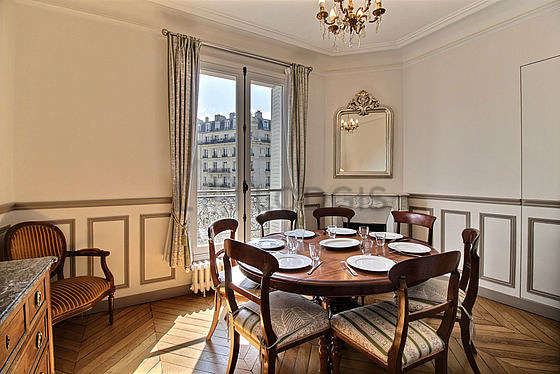 Dining room equipped with dining table, storage space, sideboard, fireplace