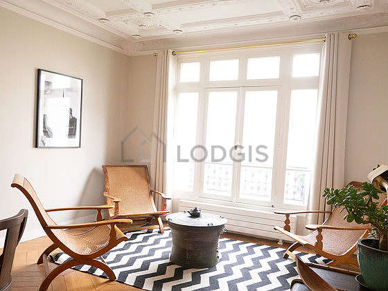 Very quiet living room furnished with 4 armchair(s), 4 chair(s)