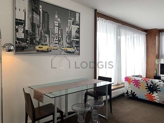 Very quiet living room furnished with 1 bed(s) of 140cm, tv, 2 chair(s)