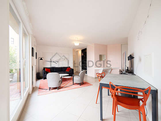 Very quiet living room furnished with tv, 2 armchair(s), 2 chair(s)