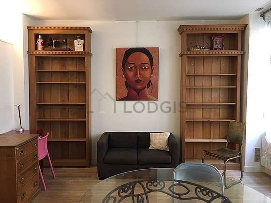 Living room furnished with tv, wardrobe, cupboard, 1 chair(s)