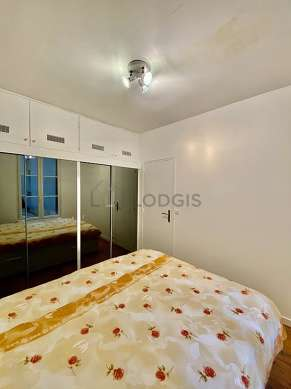 Bright bedroom equipped with wardrobe