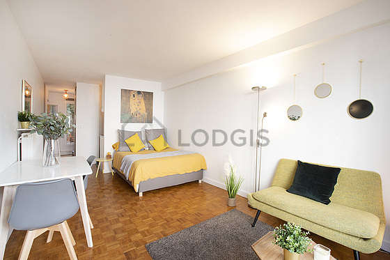 Very quiet living room furnished with 1 bed(s) of 140cm, tv, wardrobe, cupboard