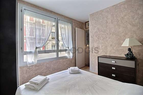 Very bright bedroom equipped with closet, storage space