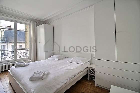 Bright bedroom equipped with closet, storage space, 1 chair(s)