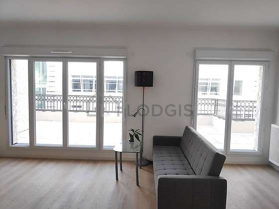 Very quiet living room furnished with sofa, coffee table, storage space, 1 chair(s)