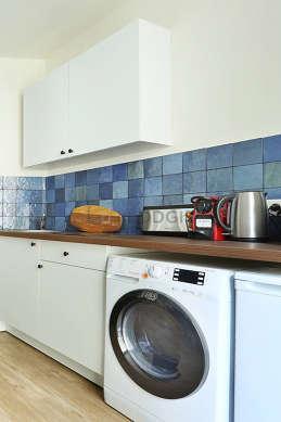 Kitchen equipped with washing machine, dryer, refrigerator