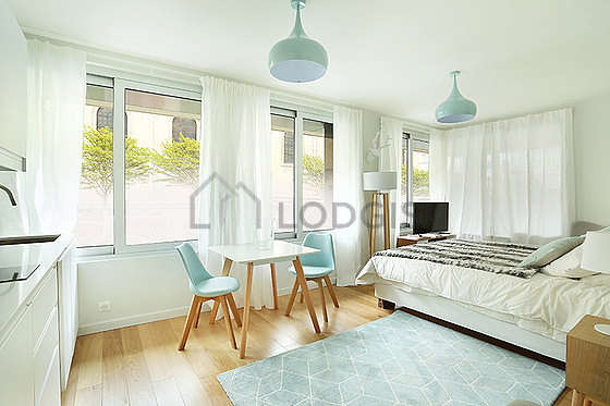 Very quiet living room furnished with 1 bed(s) of 160cm, tv, 1 armchair(s), 1 chair(s)