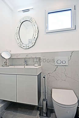 Pleasant and very bright bathroom with double-glazed windows and with marblefloor