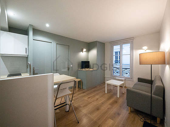 Very quiet living room furnished with tv, cupboard, 1 chair(s)