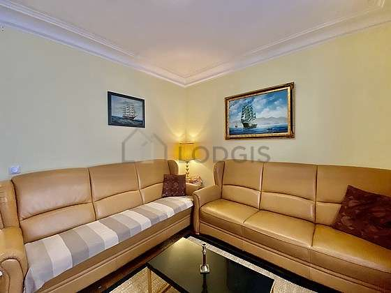 Quiet living room furnished with 2 sofabed(s) of 90cm, tv, 4 chair(s)