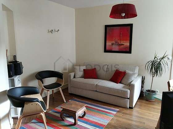 Quiet living room furnished with 1 sofabed(s) of 140cm, tv, hi-fi stereo, fan