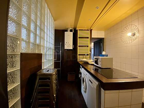 Kitchen equipped with washing machine, dryer, refrigerator, freezer