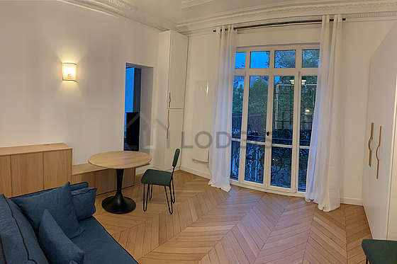 Very quiet living room furnished with sofa, closet, storage space, cupboard