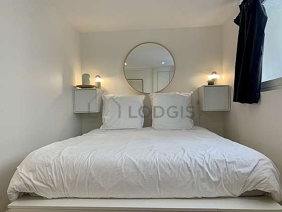 Bright bedroom equipped with storage space, bedside table