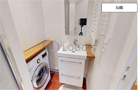 Pleasant bathroom with woodenfloor