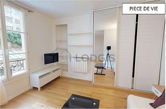 Very quiet living room furnished with 1 sofabed(s) of 150cm, tv, closet, cupboard