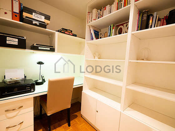 Office with woodenfloor furnished with desk, bookcase, 1 chair(s)