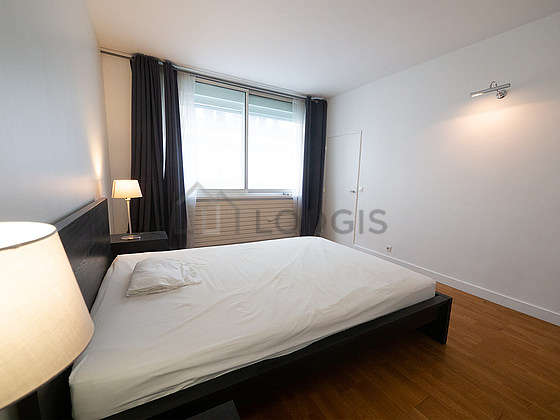 Very bright bedroom equipped with bedside table